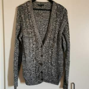 A knitted cardigan from Mango, long arms and comfy.