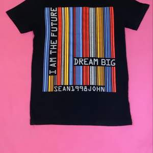 This shirt is from SEAN JOHN. Size is a S
