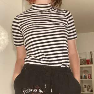 white shirt with black stripes in perfect condition. the T-shirt will be washed and ironed before sale ;)