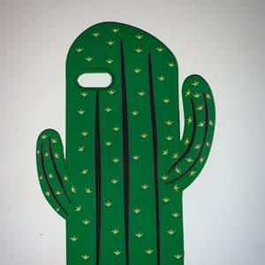 Ett grönt kaktus skal i silikon matrial som är böjbart.