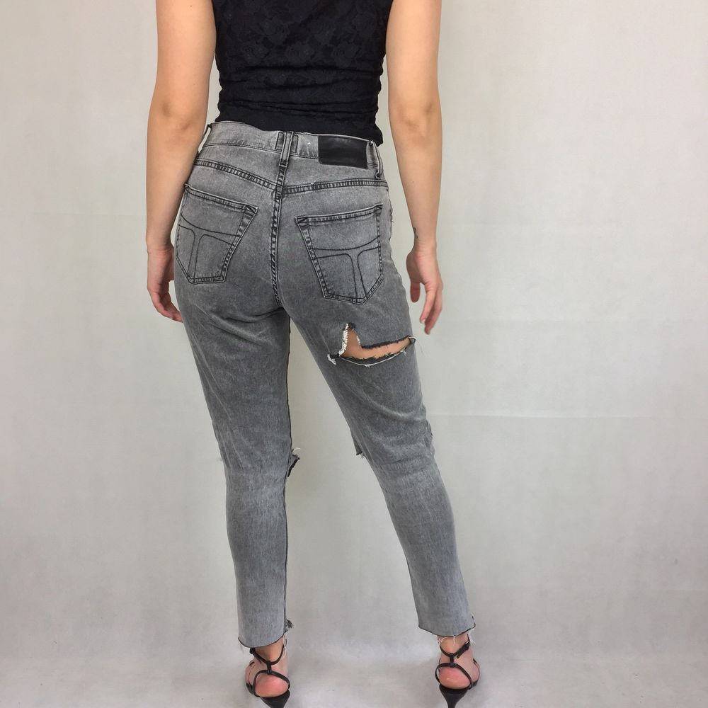 These badass high waisted thin jeans are from Tiger Of Sweden. In great condition! Handmade holes and ruffles at the bottom. Model use S for reference. No return nor refund. Free shipping.  Waist 36cm Length (from the waist and down) 91cm. Jeans & Byxor.