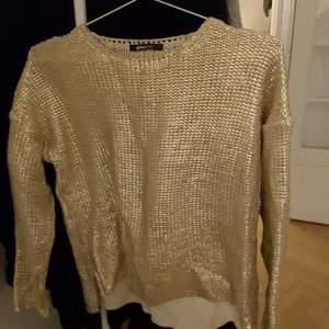 Guldig tröja