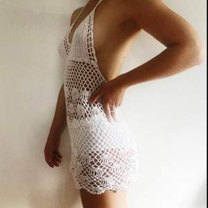 The perfect dress to wear over your bikini in summer/ at festivals! White & handmade in Bali! Great condition, like new! The material is strechy and it has a tie at the neck so the size is flexible.