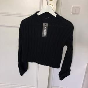 Kabelstickad tröja från Boohoo. Aldrig använd. Strl M, liten i storleken snarare S