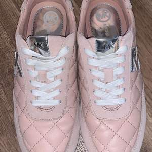 super fine shoes, purchased in Canada.  comfortable to wear and they are genuine/NOT FAKE.  It is pink leather with MK brand in silver.  used once and nothing is wrong with Them.  size 38 and comes with Michael kors package