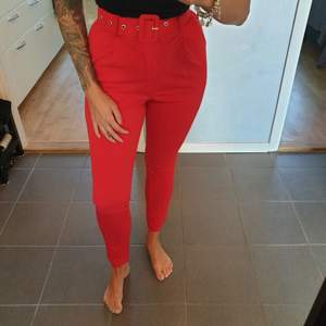 NEW still with labels red tailored trousers - size 40, but small in size, so i would say 36-38.