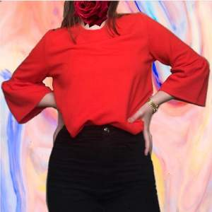 Red high-quality top with flare sleeves. Gold zip about 15cm down the back. From Lindex