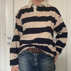 Oversized blårandig tröja från tribute. Gott skick, fin att stoppa in lite i byxan!