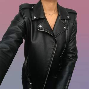Faux leather jacket | black with silver details | model is a size S; EU36/IT40 for reference.