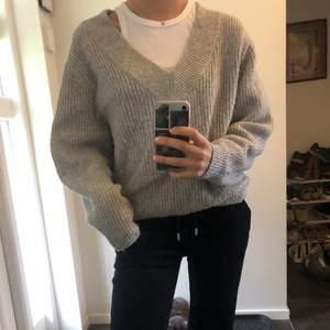 Vringad stickad tröja