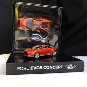 2012 Ford Evos model vehicle prepared by Ford for collectors.  Ford Evos, shown as one of the car concepts of the future, is a hybrid concept with a mixture of gasoline engine, electric motor and lithium-ion battery.  Designed by Stefan Lamm, led by Ford Europe design director Martin Smith.  1:43 scale model car in original special box.  You can register the product by scanning the QR code on the back of the box with your mobile phone.  The product is produced by Cybergroup, which produces model vehicles and promotional products of many world brands.  There is no problem or deformation in the product. It has never been taken out of its box.  Scale: 1:43 (10.5 x 4,5 x 3 cm) Manufacturer: Norev France Model year: 2012 Colour:  Red Hot Chilli Item number: 003215369FDD73BF Weight: 400 gr Box Scale: 17x16x8 cm