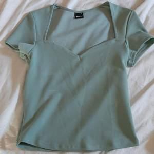 Grön tröja från Gina tricot i storlek XS
