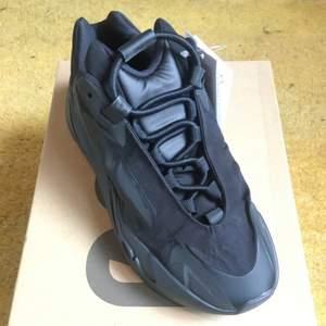 Yeezy 700 MNVN triple black. Size US 6 / EU 38 2/3. Brand new. All original + receipt. No trades. Buyer adds shipping costs.