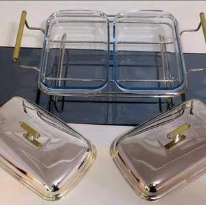 Let your hot food service to your guests be first class. Hot food service set of world famous kitchen brand Marinex produced in Brazil.  The set consists of two heat-resistant glass containers with lids and a steel frame in which two containers are seated.  High quality Marinex table service. Place of manufacture: Brazil. Binocular.  Stainless steel. Very elegant, never used.  Rectangular Stainless Steel Tray Weight: 1.250 gr Dimension: 48 x 29 x 14 cm  Glass Dish With Lid Weight: 1.350 gr (Each) Dimension: 28 x 17 x 4 cm Capasity: 2 lt.    https://youtu.be/SMaS1kI28C0