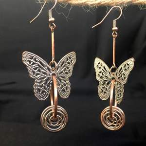 Crafted with a very exquisite workmanship. There is a nickel plated fine copper engraving butterfly motif on the upper part and a handcrafted copper wire auger cocoon motif on the lower part. It brings the two together in the middle elegant brass ring. https://youtu.be/kwxSpPqN4as