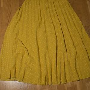 Flowy yellow skirt with white dots