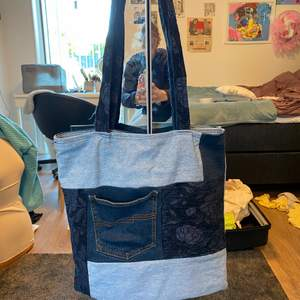 Selling a hand sewed tote bag, made out of denims. The bag is super large and cool, and is so handy for picnics or trips…anything where you need a bigger bag. It has a small pocket in the front to fit a phone and a few small things.