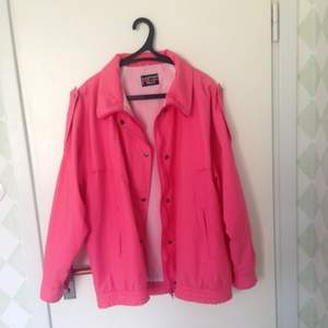 Retro pink jacket. It says girls but boys can rock it too. It's light. Not too warm. Good for the late night chills. Colour not fading. Just bad picture quality