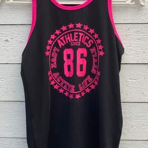 Bra linne för träning med rosa detaljer