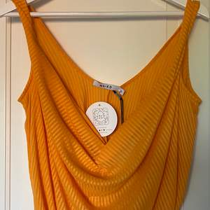 Orange Linne, aldrig använt.