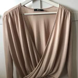 En superfin smutsrosa tröja i storlek xs/s, 60kr