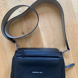 An italian brand fashion bag, only use 2 times and pretty new, black soft leather with many layers of small bags.