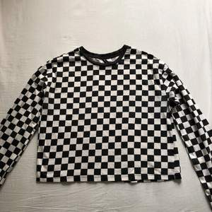 Checkered långärmad tröja i storlek S