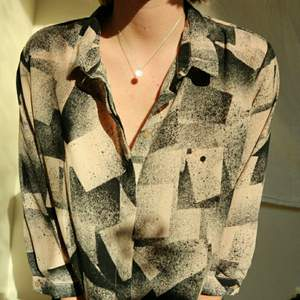 Blouse monki beige and black squared pattern