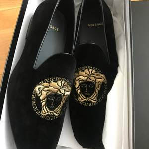 Fancy velvet flats from versace. In new condition only tried on.