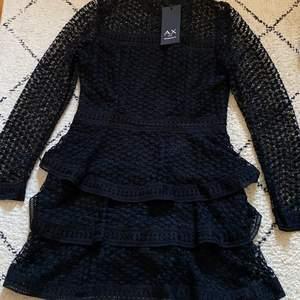 En fin svart klänning helt oanvänd