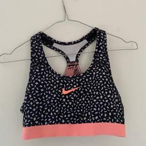 Sporttopp från Nike. Toppenskick!