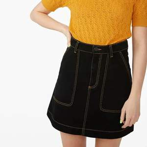 black denim skirt with yellow contrast stitching from monki, worn once. super cool and has pockets!!!!!!