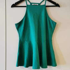 Beautiful Green pemplum top from Gina Tricot, never used. Stretch material and pretty for the summer 😉 size L