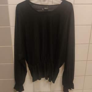 Peplum top black XL, never used.