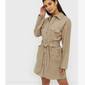 Snygg coat dress från Nelly helt oanvänd