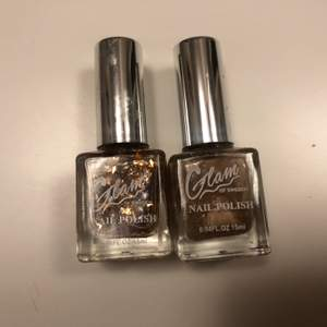 A bundle of two nail polishes that go great together. One is a brown golden gray color and the other one is a orange bronze glitter polish. Both a new and unopened.