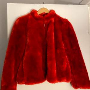 Super cute and sassy scarlet fluffy jacket perfect to throw on over anything, perfect condition. Has pockets. Great for evenings! Has never been woren.