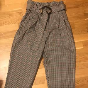 Great condition suit pants from Mango with belt. European size 36 but fits a 38 as well.