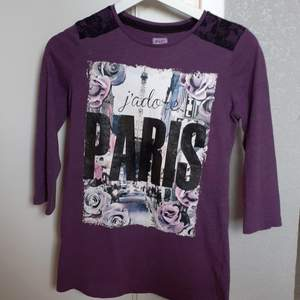 Dark purple jumper, jumpers hands are shorter than usual