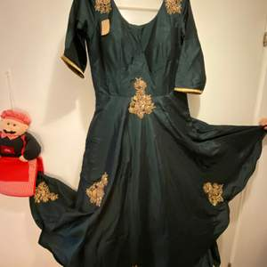 Green coloured evening gown for parties...elegant wear....never used and has a tag...has 5 layers of clothes inside to give an elegant look...has a zip at one side for best fitting...also has 10 cm of space available for alteration