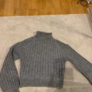 Stickad tröja från Nelly.com i storlek s