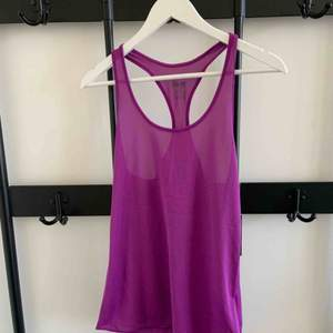 Nike Dry Fit tank top Brand: Nike Size: S Colour: Purple  Never worn. Still has tag. 2 years old.