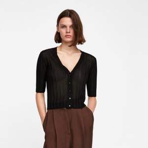 Black fine ribbed knit cardigan from Zara. Very nice material. Never used, condition is perfect. Size S, Will fit smaller too.
