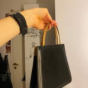 brun och svart minibag i väldeligt bra skick💞💞💞