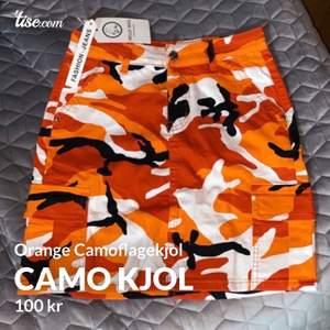 Camoflauge kjol från JFR. Storlek 38. lapparna kvar.