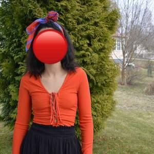 Orange bohemian style top. Frakt tillkommer.