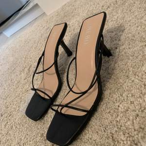 Black strap heels size 37. Condition as new, have only used once outside. Selling because they're slightly too small for me.
