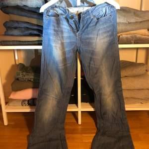 Snygga ljusblå lågmidiade byxor/vintage
