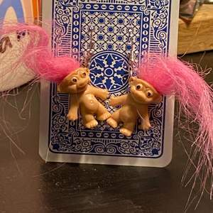 these cute trolls earring are one of my fave things im selling. About the size of a playmobile person (if you know what that is lmao) im having a hard time explaining how big they are but for reference the card they're hanging on a normal playing card.