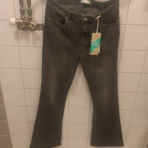 Grey flare jeans, never used XL.